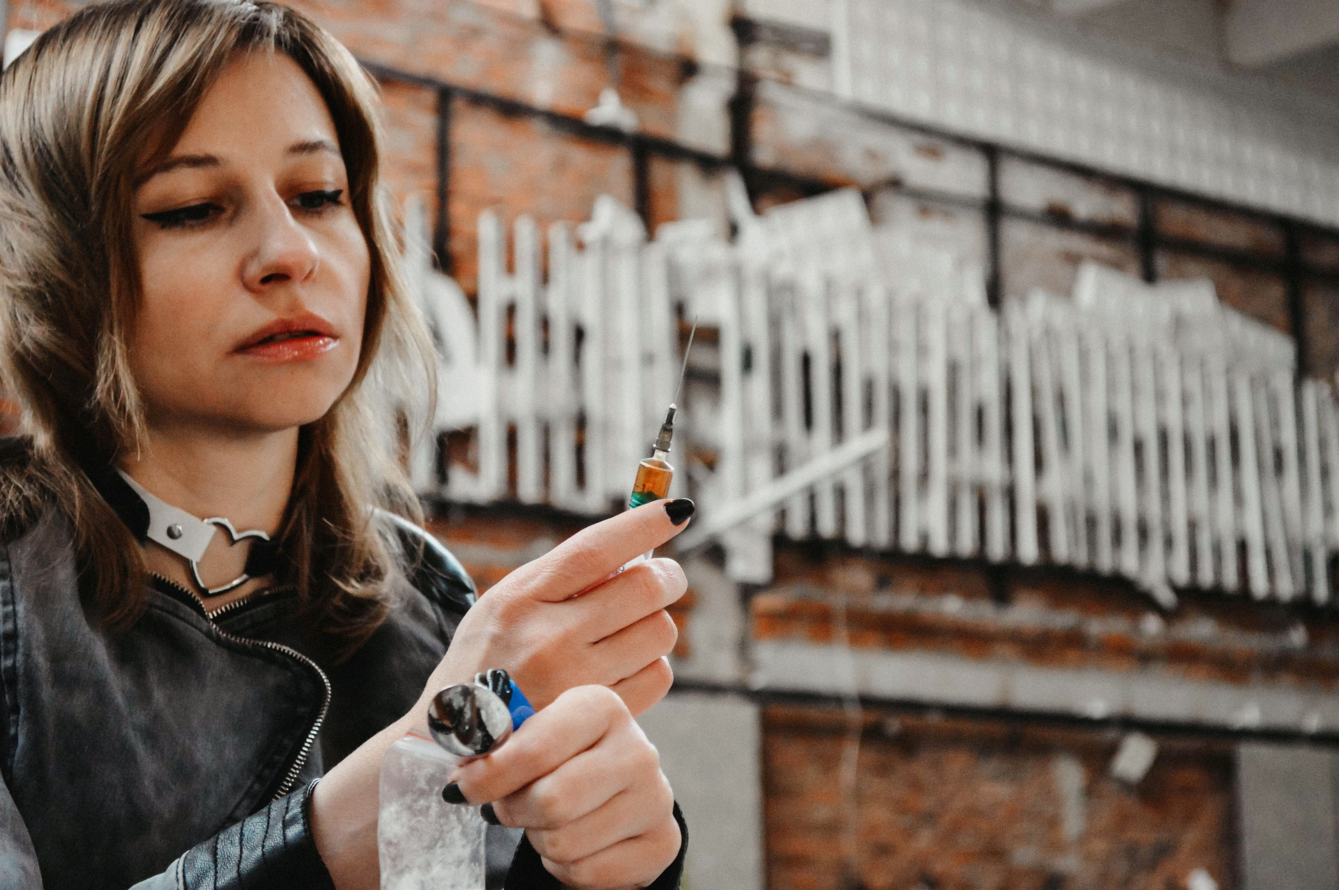 Woman with the tools used to further her cocaine addiction